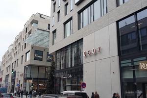 Die detailreiche Fassade sorgt für eine stimmige Verankerung des Quartiers in seiner Umgebung.