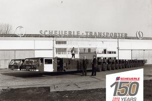 Vor über 30 Jahren wurde der erste Scheuerle SPMT entwickelt und an das niederländische Spezialtransportunternehmen Mammoet ausgeliefert. In diesen 30 Jahren hat der SPMT weltweit Transportgeschichte geschrieben. Der Herr in der Mitte ist Firmeninhaber Otto Rettenmaier. (Quelle: TII Group)