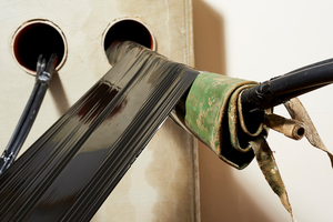 Wrap Tech Solution, Wickelpacker für die Sanierung kabelbelegter Rohre.