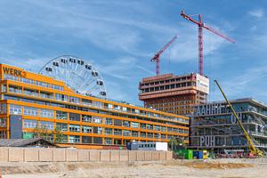 Das Werksviertel am Münchner Ostbahnhof entwickelt sich zum spannenden Architekturschauplatz, dominiert vom neuen, 86m hohen Werk 4.