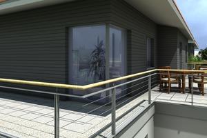 Die oberste Etage entspricht einem Laternengeschoss und lenkt durch die graue Steinfassade den Blick auf sich.