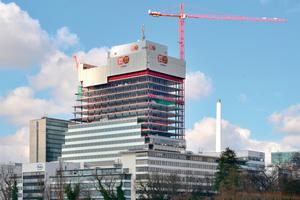 """Der Turm """"Bau 1"""" wird der neue Haupteingang zur Roche-Zentrale in Basel mit Platz für 2000 Arbeitsplätze."""