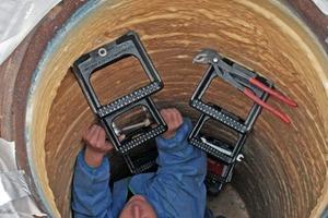 Einbau von neuen Tritteisen in den sanierten Mauerwerkschacht<br />