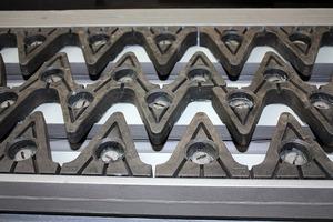 Lamellenübergang mit elastomerbeschichteten, lärmmindernden Zusatzelementen<br /><br />